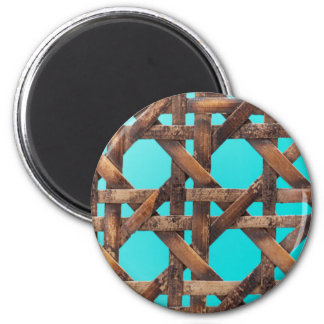 A macro photo of old wooden basketwork. magnet