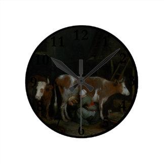 A Maid Milking a Cow in a Barn Round Wallclock