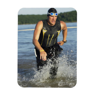 A male athelete running out of the water while 2 vinyl magnets
