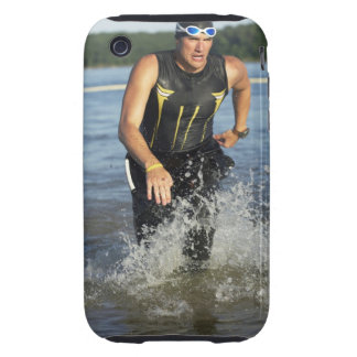 A male athelete running out of the water while 2 tough iPhone 3 cover