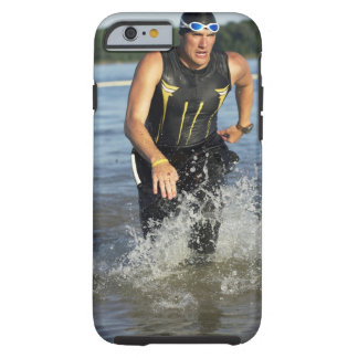 A male athelete running out of the water while 2 tough iPhone 6 case