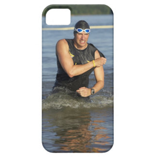A male athelete running out of the water while iPhone SE/5/5s case