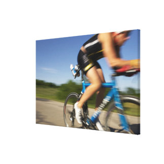 A male athelete training for a triathlon at a canvas print