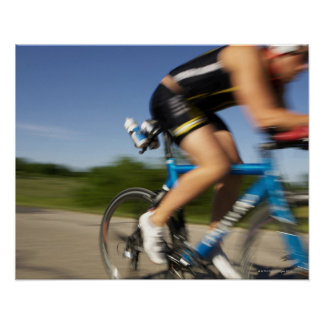 A male athelete training for a triathlon at a poster