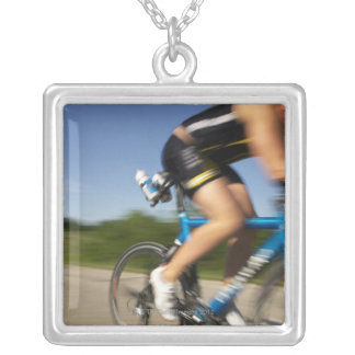 A male athelete training for a triathlon at a silver plated necklace