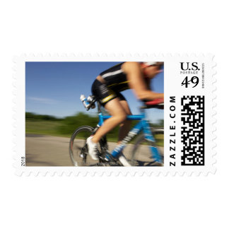 A male athelete training for a triathlon at a stamp