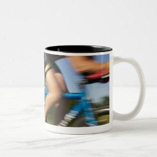 A male athelete training for a triathlon at a Two-Tone coffee mug