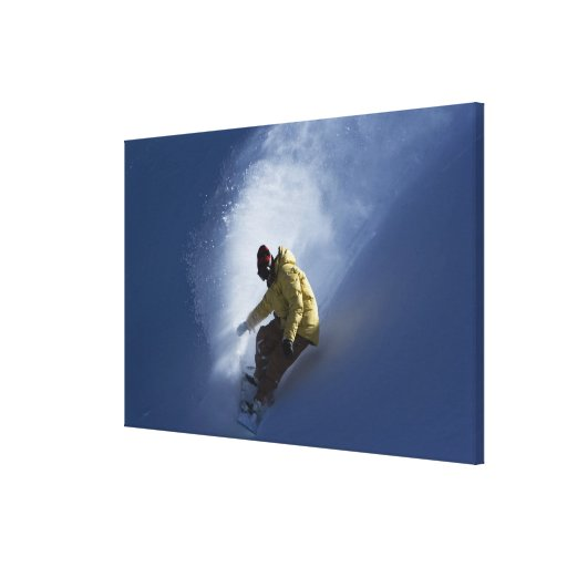 A male snowboarder catches last light on a canvas print