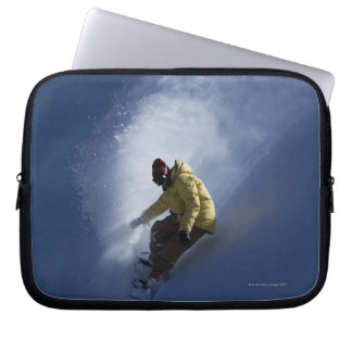 A male snowboarder catches last light on a laptop computer sleeve