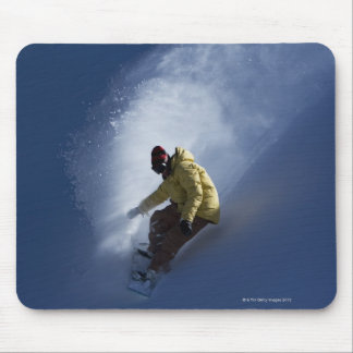 A male snowboarder catches last light on a mouse pad