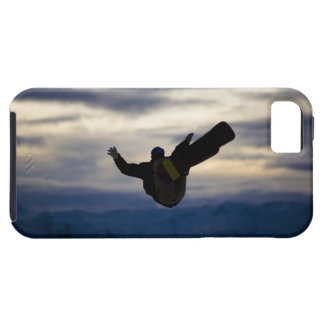 A male snowboarder does a back flip while riding iPhone 5 covers