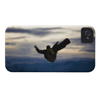 A male snowboarder does a back flip while riding iPhone 4 cover