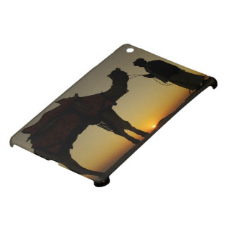 a man and his camel Silhouetted at sunset on the Case For The iPad Mini