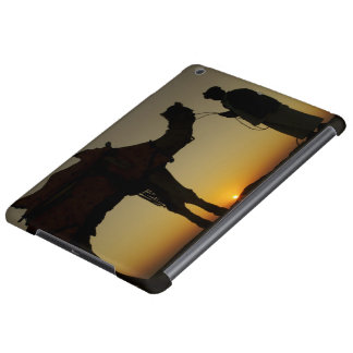 a man and his camel Silhouetted at sunset on the Cover For iPad Air