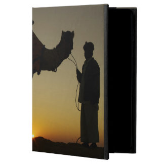 a man and his camel Silhouetted at sunset on the iPad Air Cover