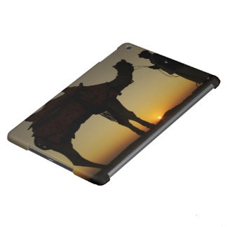 a man and his camel Silhouetted at sunset on the iPad Air Covers