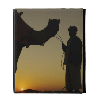 a man and his camel Silhouetted at sunset on the iPad Folio Cover