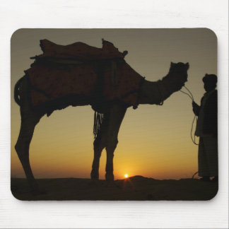 a man and his camel Silhouetted at sunset on the Mouse Pad