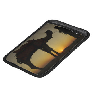 a man and his camel Silhouetted at sunset on the Sleeve For iPad Mini
