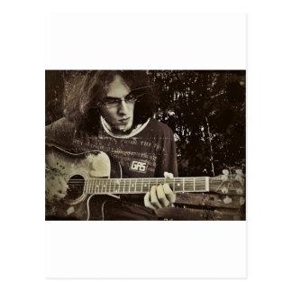 A man and his Guitar. Postcard