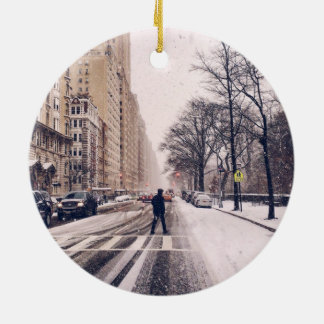 A Man Crossing A Snowy Central Park West Ceramic Ornament