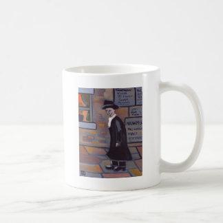 A MAN IN A TRILBY HAT COFFEE MUG