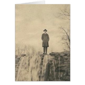 A man on a cliff card