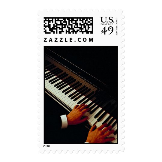 A man playing piano postage