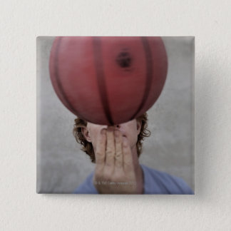 A man spinning a basketball ball on his finger button