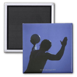 A man with a volleyball 2 inch square magnet