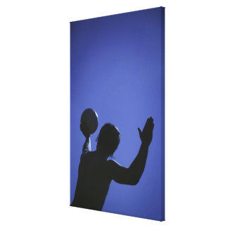 A man with a volleyball stretched canvas print