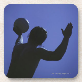 A man with a volleyball coaster