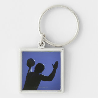 A man with a volleyball keychain
