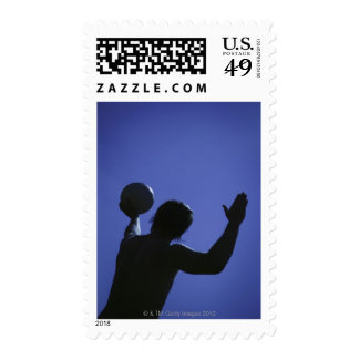 A man with a volleyball postage stamps