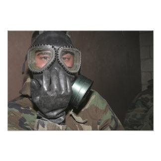 A Marine clears his gas mask Photo Print