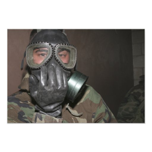 A Marine clears his gas mask Photo