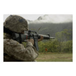 A Marine conducts drills Poster