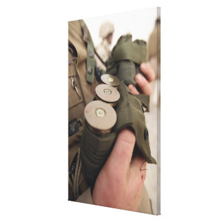 A Marine cradles handfuls of 40 mm grenades Canvas Print