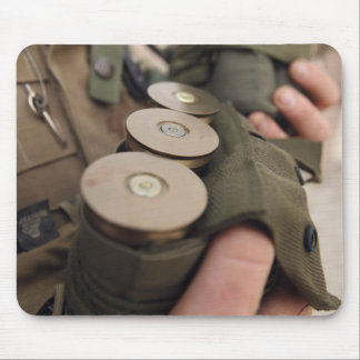 A Marine cradles handfuls of 40 mm grenades Mouse Pad