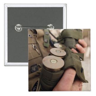 A Marine cradles handfuls of 40 mm grenades Pinback Button