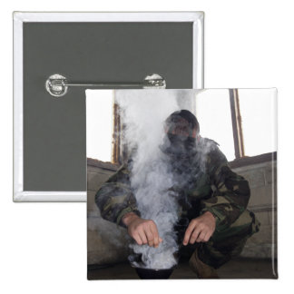 A marine fills the gas chamber with more CS gas Pins