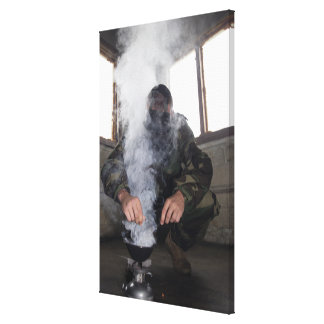 A marine fills the gas chamber with more CS gas Stretched Canvas Print