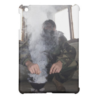 A marine fills the gas chamber with more CS gas Cover For The iPad Mini