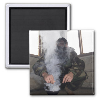 A marine fills the gas chamber with more CS gas Fridge Magnet