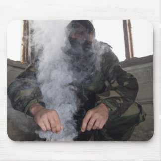 A marine fills the gas chamber with more CS gas Mouse Pad