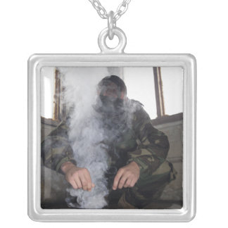 A marine fills the gas chamber with more CS gas Personalized Necklace