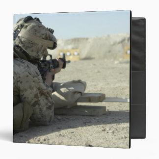 A Marine fires a M16A2 service rifle Binder