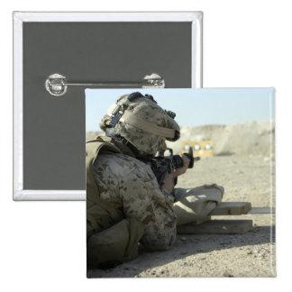 A Marine fires a M16A2 service rifle Button