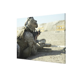 A Marine fires a M16A2 service rifle Canvas Print