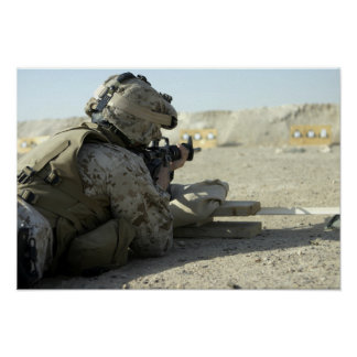 A Marine fires a M16A2 service rifle Poster